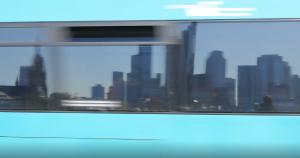 Mirroring the Frankfurt skyline in the windows of a moving transport means.